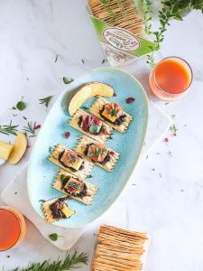 A tray of croccantini with bacon jam, cheese and prosciutto